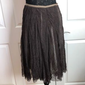 Sheer lacy type brown skirt with lining